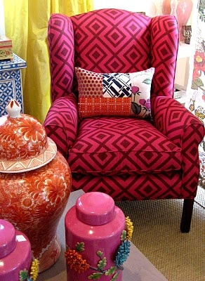Wing chair covered in La Fiorentina fabric from Absolutely beautiful Things by Anna Spiro...I don't like the vases.