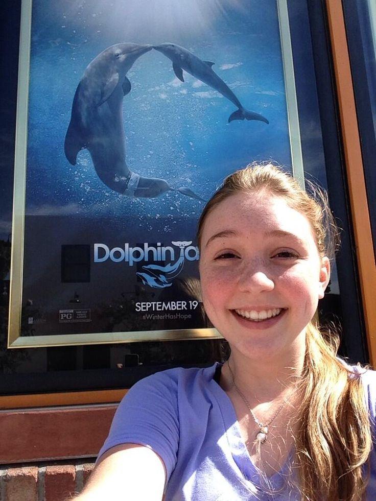 Cozi Zuehlsdorff selfie in front of DT2 poster.