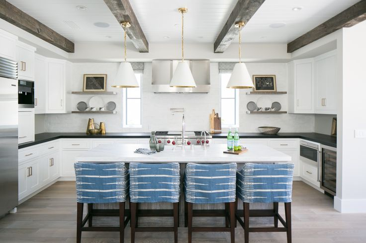 kitchen + white kitchen + reclaimed wood beams