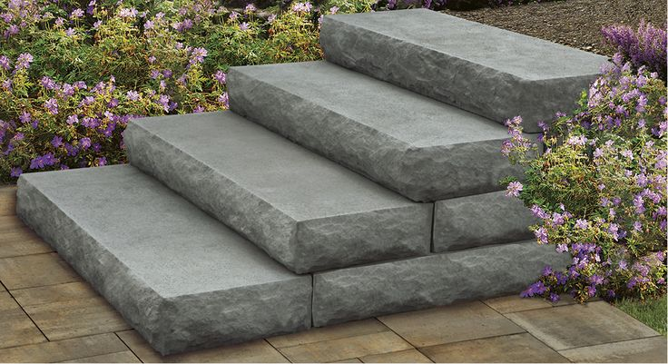 Cambridge Pavingstones' Cast Stone Steps are a great addition to any backyard.