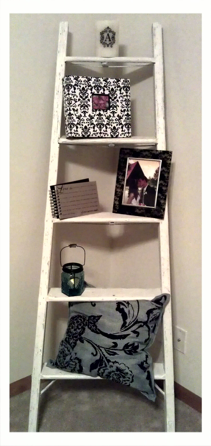 Ladder Shelf...half of a ladder painted shabby chic white & decorated.