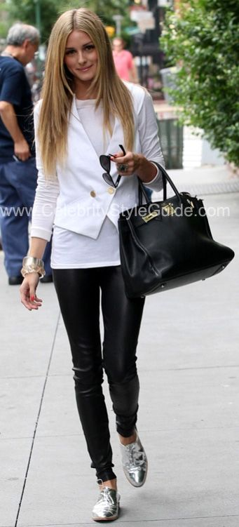 Olivia Palermo in black leather leggings and white jacket with silver brogues.
