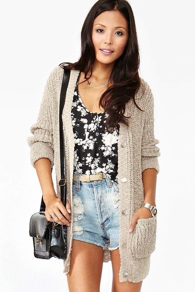 Just the sweater. What kind of atmosphere is this girl exploring with a heavy knit sweater and daisy dukes??