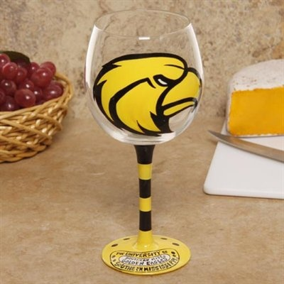 Beverages sipped Southern Miss style from this hand-painted wine glass.