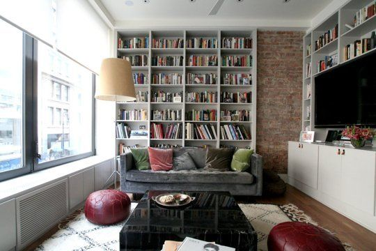 """Living Room Layout Ideas: Place a Bookcase Behind Your Sofa """"Weird room layouts and architectural element placement can make putting a sofa behind the sofa the smartest choice"""""""