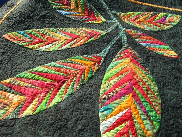 Beautiful pieced leaves and fun, wonderful quilting
