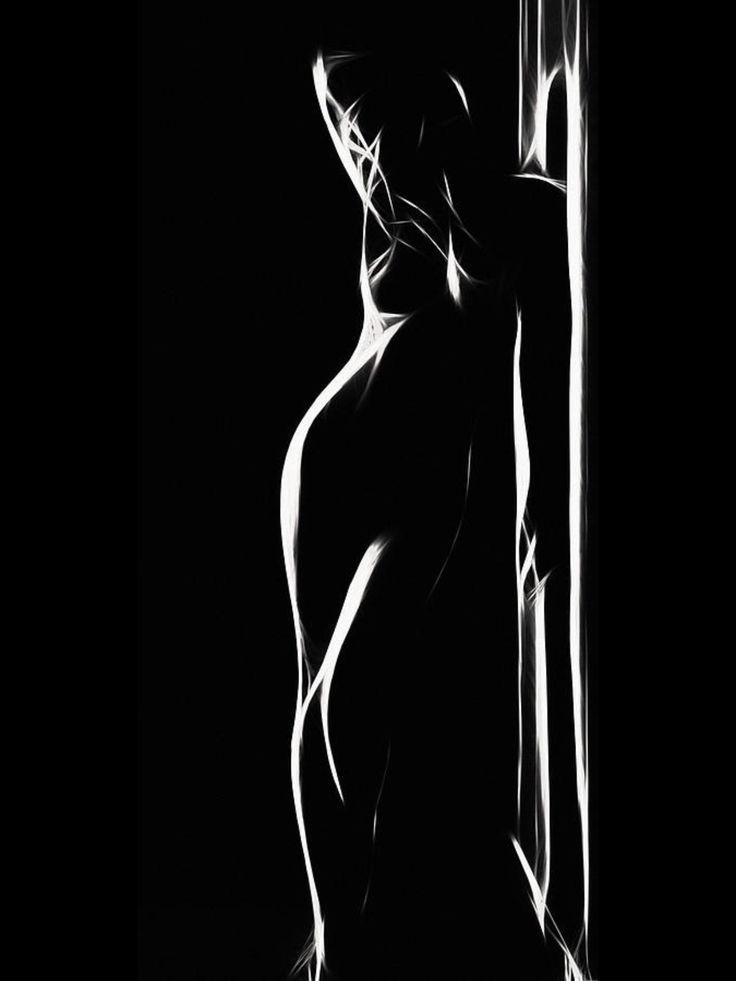 An near-abstract woman silhouetted by high-contrast light.