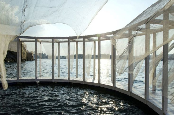 Those who want to relax on this floating wooden pavilion in Malta can reach it only by swimming or taking a boat.