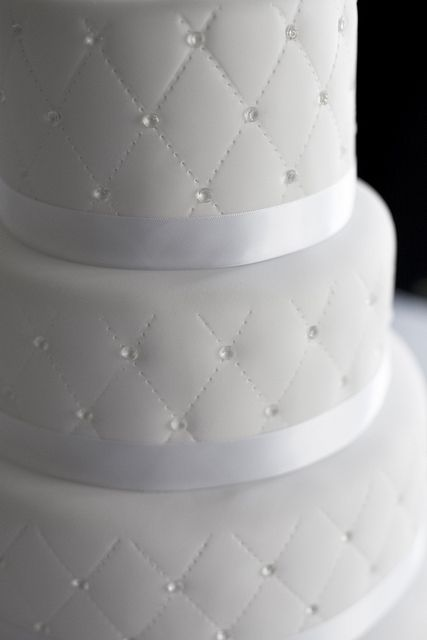 wedding cake with edible sugar diamonds... But use pearls instead and throw a big peony bloom on top :-)
