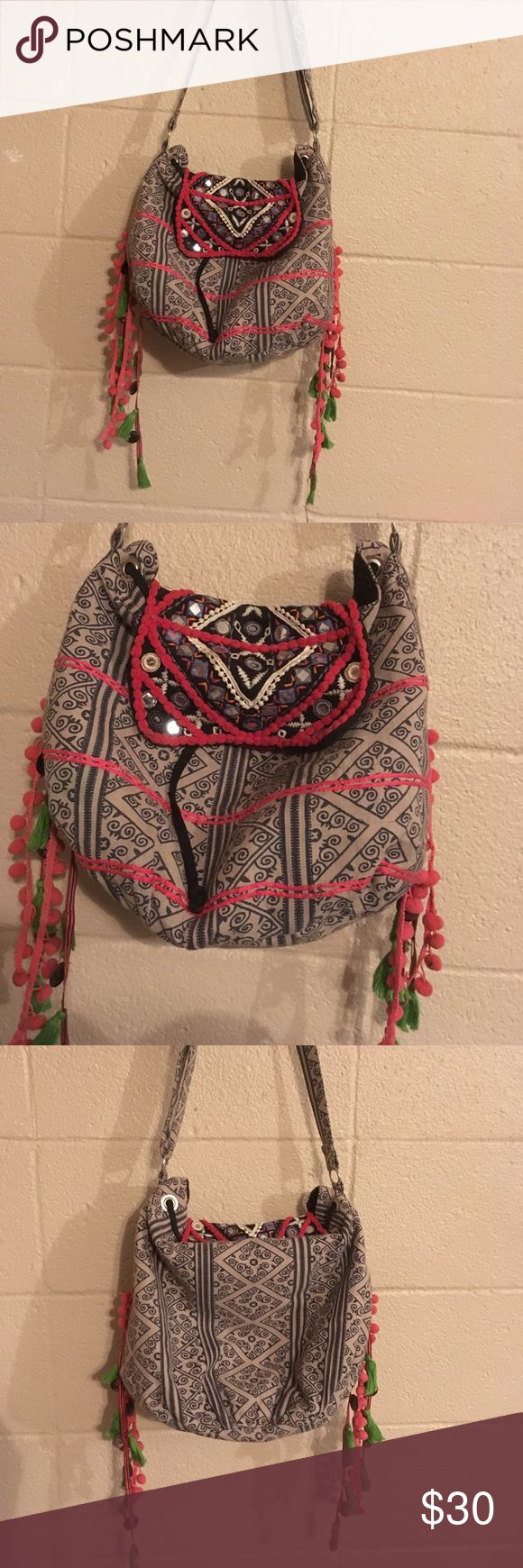 Embroidered Purse embroidered purse with glass embellishments and tassel detail. Excellent condition, basically new! Medium sized bag, from UO. Urban Outfitters Accessories
