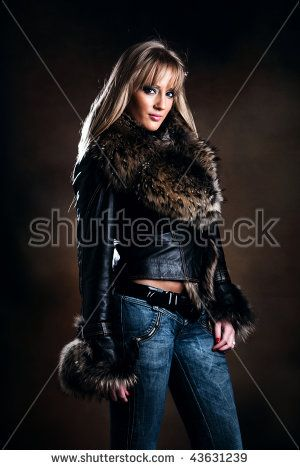 beautiful blond in leather jacket with fur