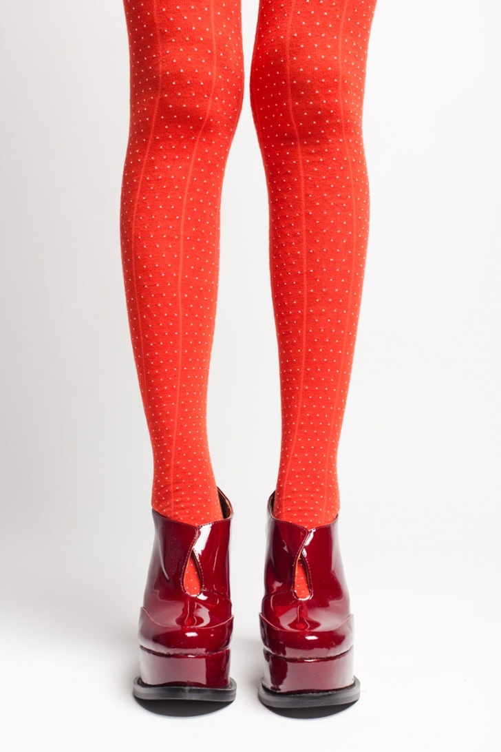 Red tights with tiny white polka dots and shiny bordeau wedge boots