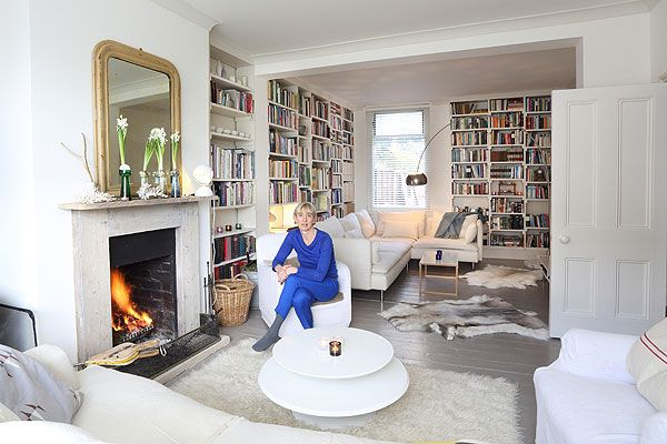 Look at the bookshelves! Covet. Ideally I'd have some different sized sections within the shefor photos, a painting, bar area (maybe), vases etc