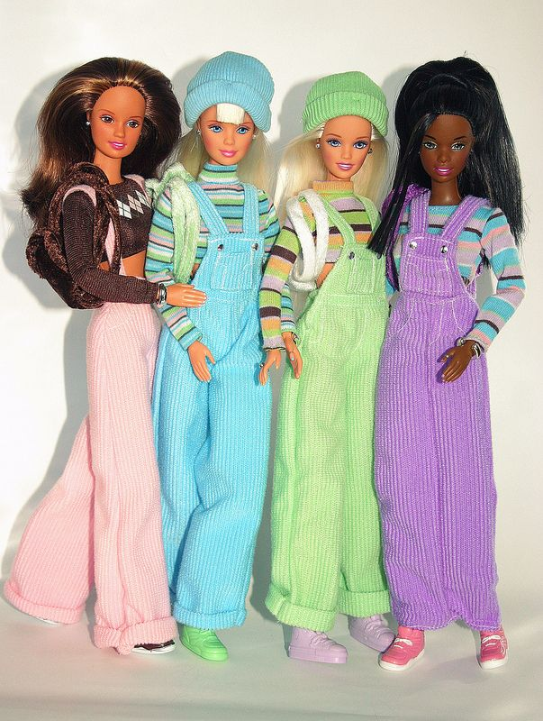 Cool Colors! I had the pink Teresa doll!  Each doll came with a tube of colored hair paint corresponding to whichever color your doll was.  You could brush streaks of color onto your doll's hair as well as your own.  I loved this doll! pink Teresa, blue Barbie, green Skipper and purple Christie