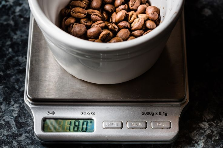 18g whole roasted coffee beans on scales
