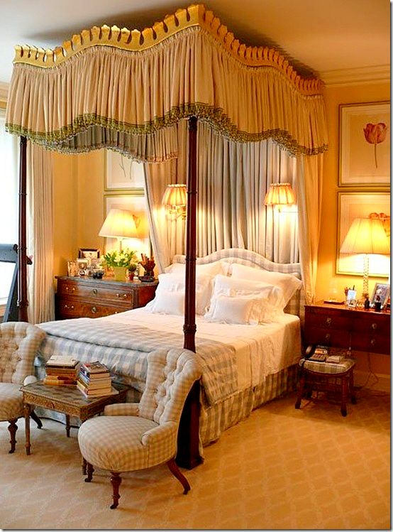 """This gorgeous bed uses a dressier """"unmade bed"""" look, with a duvet and an emphasis on the fine linens."""