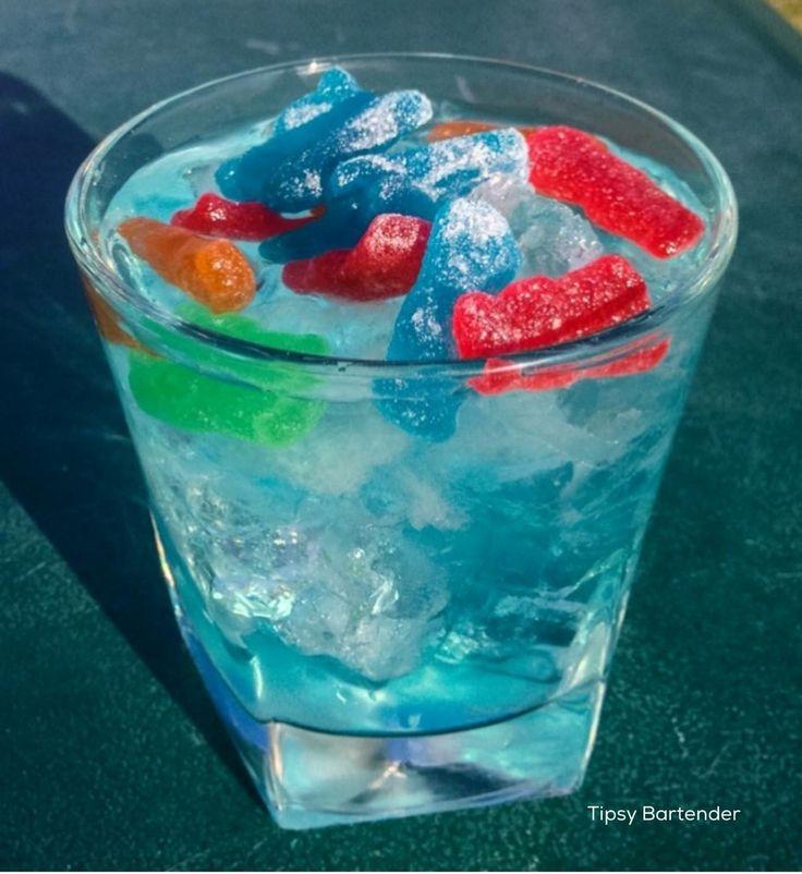 DRUNK LIL KIDS 1/2 oz. (15 ml) Raspberry Vodka 1/2 oz. (15 ml) Green Apple Vodka 1/2 oz. (15 ml) Island Punch Pucker 1/2 oz. (15 ml) Peach Schnapps Splash of Blue Curacao 1 oz.(30 ml) Lemonade 2 oz. (60 ml) Lemon Lime Soda Sour Patch Kids