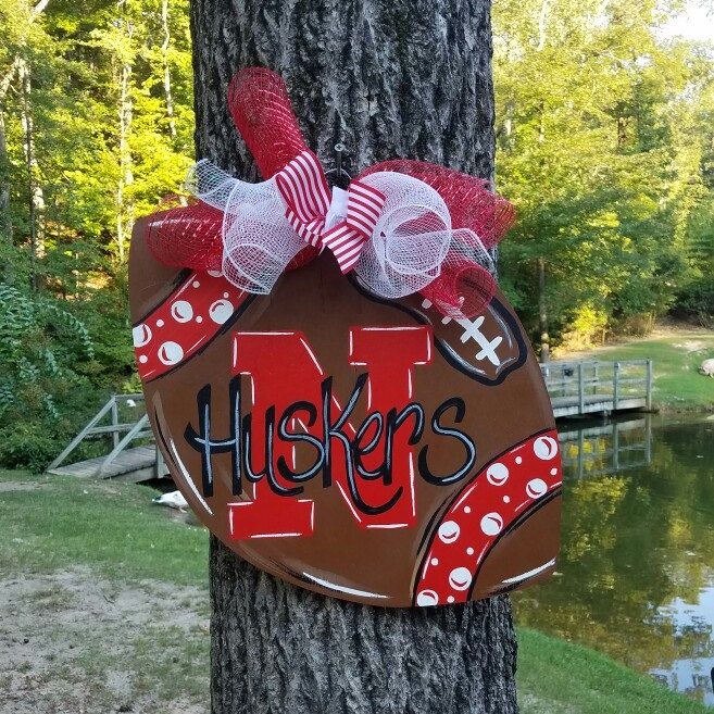Get your Game On with this door hanger this football season. Who's your favorite team ? Painted with any team you need