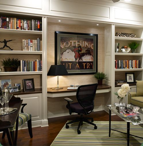 Great built in shelving desk nook. The lighting is the key to this great design.