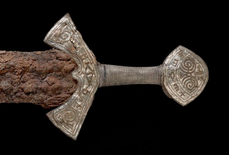 After four painstaking years of research, a sword found in a Viking burial ground has been revealed, linking the deceased to battles in England.