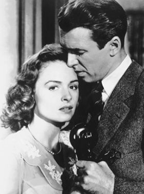 """Watching It's a Wonderful Life may be a holiday tradition for many now, but when it opened in theaters on this day in 1946, the film was a box office flop. Another little-known fact about the classic's rocky start? The first take of Donna Reed and Jimmy Stewart's phone scene kiss was deemed too """"passionate"""" to pass the censors."""
