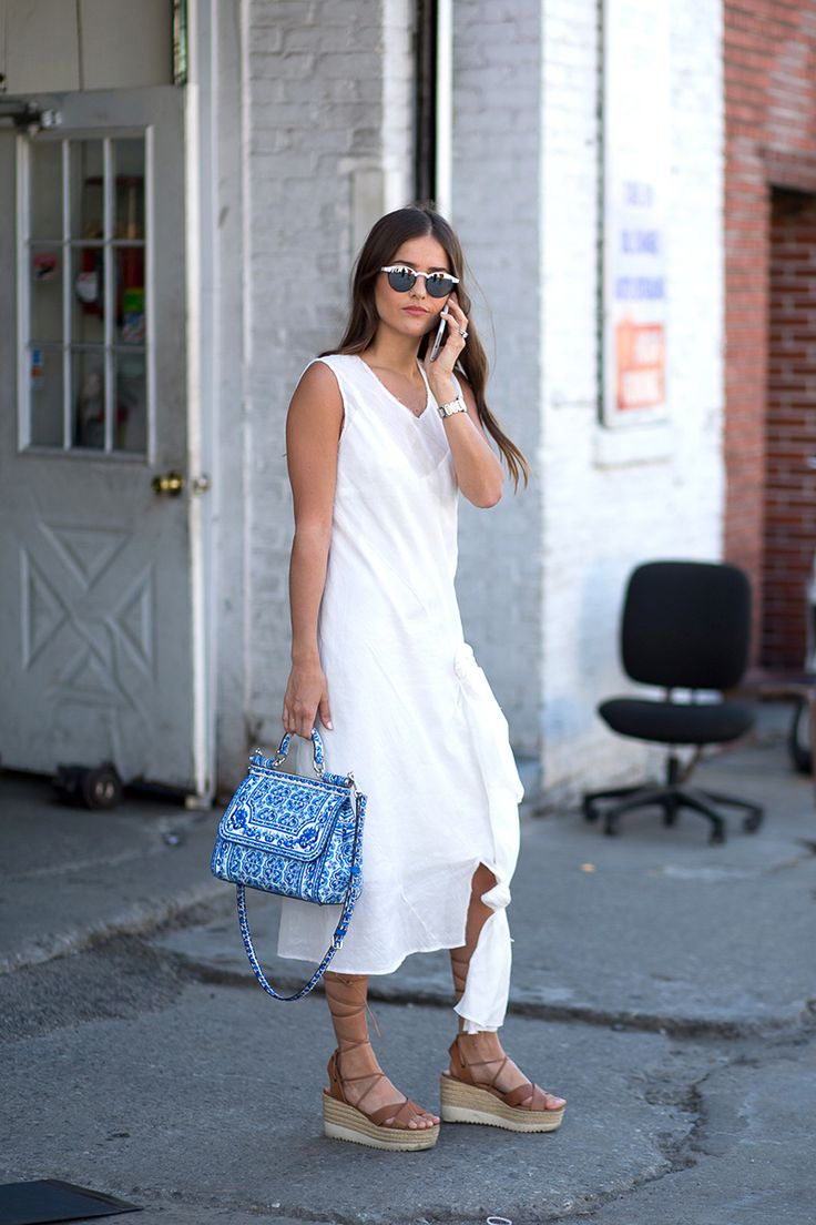 You can never go wrong in a white sundress and camel wedges lace-up wedges.
