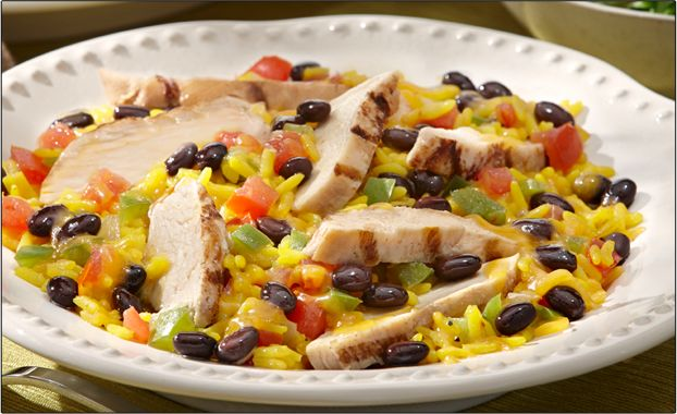 Fall for this Cheesy Chicken, Beans and Yellow Rice recipe! Made with GOYA® Beans and Yellow Rice, this dish is ready in just half an hour!
