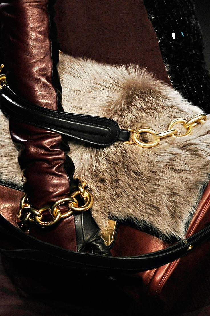 Sometimes I come across fur coats that are worn out in spots.  Why not add it to the flap of the purse like this.  Won't it be fabulous?
