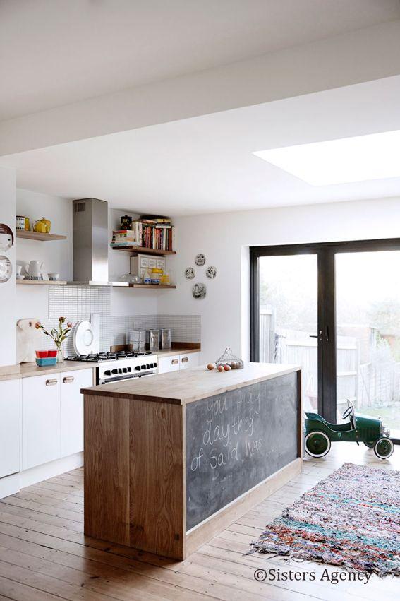 Blackboard kitchen island. Tamsin Flower's cheerful London home. Birgitta Wolfgang / Nathalie Veil, Sisters Agency.