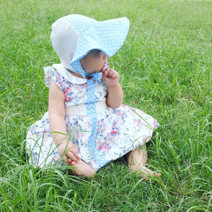 """Little missy pondering in her freshly sewn Beach Bonnet at our family Easter Sunday picnic brunch. I've stretched out her 0-3month PP dress (no pun intended ) to match her bonnet by sewing in a 1"""" strip down the middle front. A great way to extend the wear from cute cotton dresses and tops"""