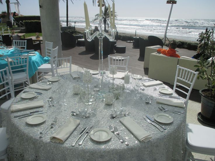 Marbella Weddings. Table set up at the Estrella Del Mar Beach Club over looking the Ocean.