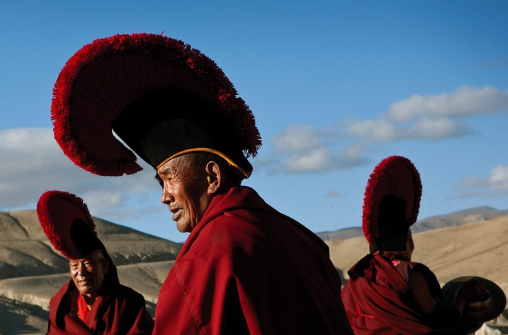 A group of senior monks gather for a ceremony on a field outside of Lo Manthang. (Taylor Weidman/The Vanishing Cultures Project)