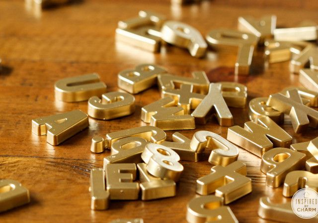 DIY Gold Magnet Letters | Inspired by Charm - sweep under the fridge for these little magnets and spray them gold for a fancy upgrade. So cute! Makes a white fridge look much better.