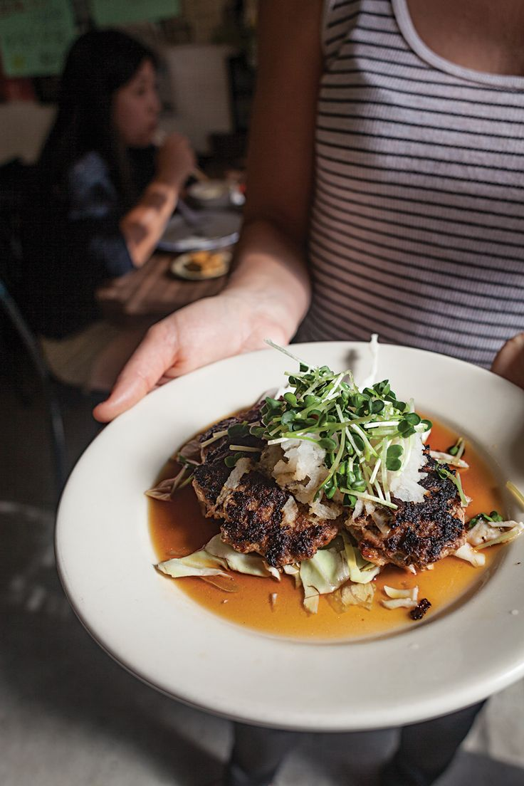 At Ethel's Grill on Oahu, Hawaii, juicy pork-and-beef patties are served over salty-sweet ponzu sauce and crisp cabbage, and topped with grated daikon and spicy sprouts.