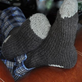Here's a quick and easy pattern for some very warm house-socks for your favorite guy (I say guy because they are sized for a man's foot – US size 10 1/2 – 12). They only take a few hours to knit, so are perfect for a last minute gift! I used Encore worsted (doubled) to ensure that they could take some abuse (or at least washing). They're worked from the toe up and are a quick way to try out Judy's magic cast on (my favorite for toe-up socks) and a toe up heel flap.