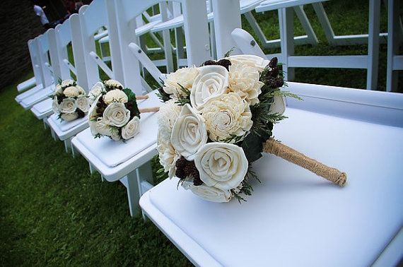 This bridal bouquet is a beautiful keepsake for after the wedding. The bouquet is composed of cream colored sola flowers, natural miniature