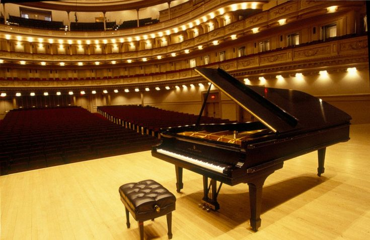 A Steinway piano in place on stage at Carnegie Hall before a concert.