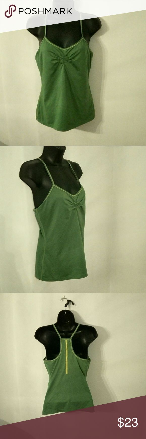 Athleta Medium Green Tunic Tank Top Racer Back Adorable and super soft and comfy Athleta brand green tank top with yellow accents.  Size medium and featuring a racer back style.  Shelf bra. Athleta Tops Tank Tops