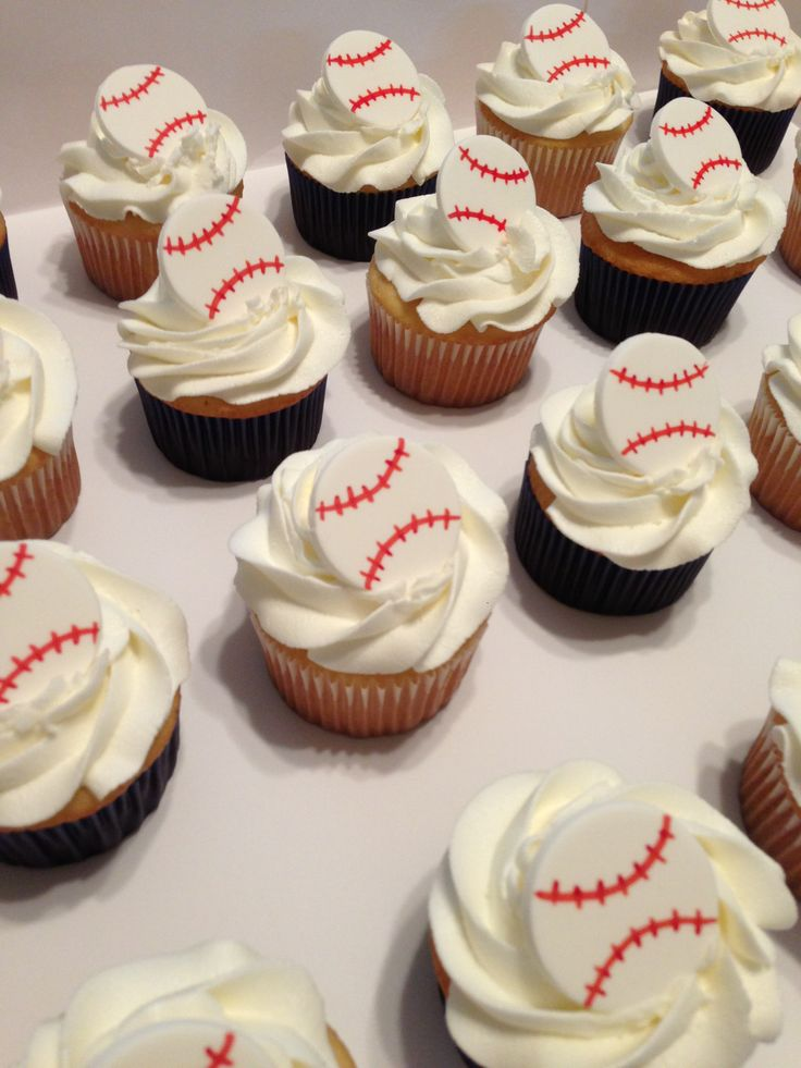Baseball cupcakes - Simple vanilla cupcakes with buttercream frosting. Gumpaste baseballs drawn with edible marker.