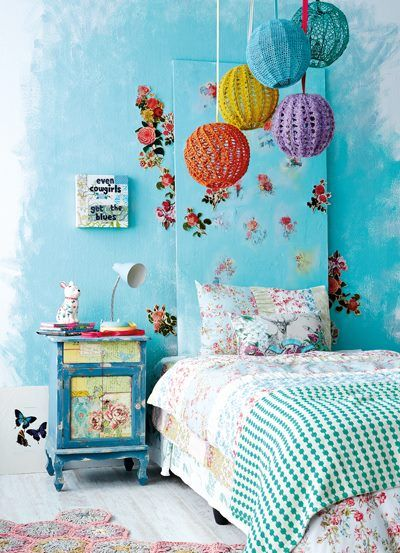 Recreate this headboard by painting a piece of wood the same colour as your wall. Decoupage paper flowers