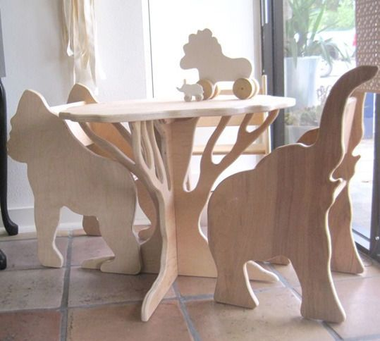 I love these wooden animal/tree table and chairs. Gorilla, elephant and giraffe.