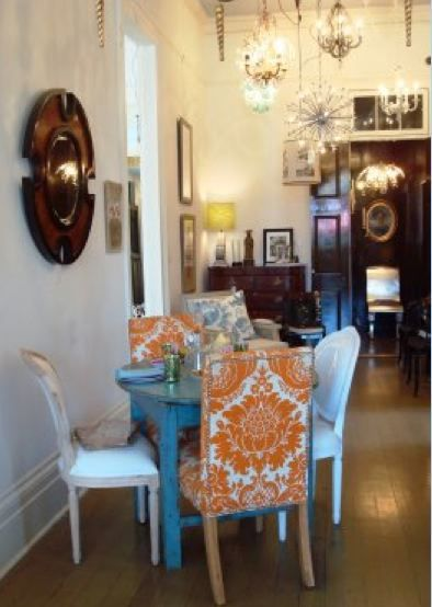 Room inspiration from Laura Casey Interiors (love the orange chairs with turquoise   table)