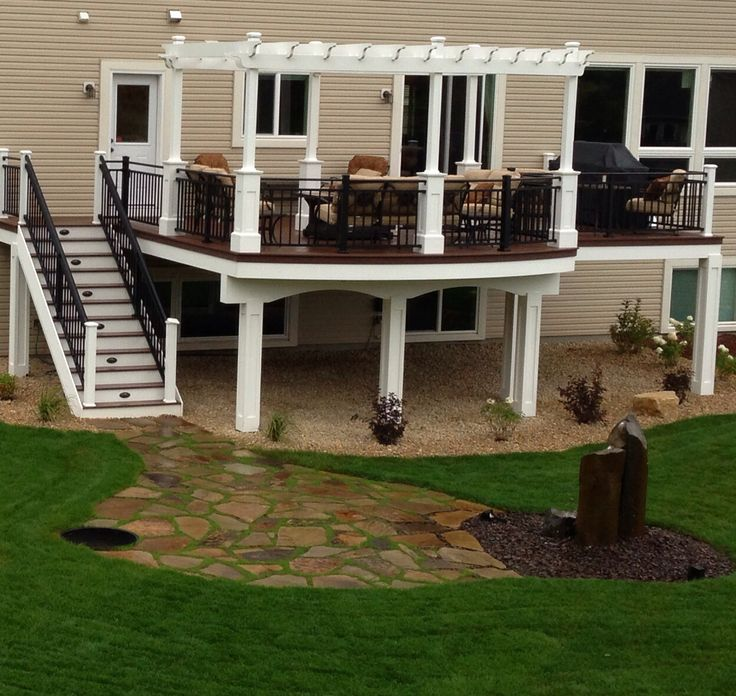 Back yard deck with patio at base of stairs techdeck for Decking in back garden
