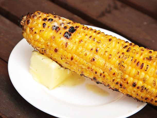 3 Ways to BBQ Corn on the Cob. My favorite #2 - Shuck corn, discard silk and husk. Wrap corn in heavy duty aluminum foil, with or without a flavored butter or oil inside. Grill directly on hot coals, or on top of a grate set over the coals, turning occasionally until fully cooked, about 15 minutes. This is easy to serve and the foil will keep the corn hot for a long time, making this a good method to use for large gatherings or buffet-style service.