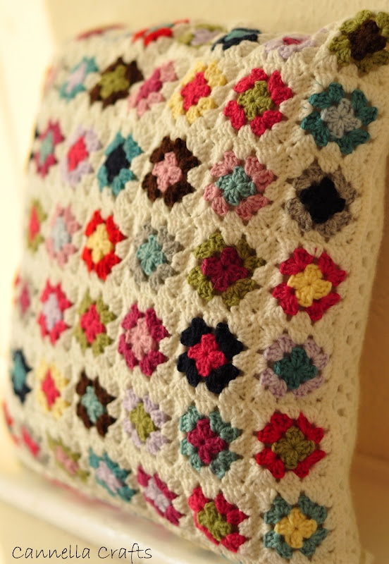 This is so pretty! I would love to make one---maybe two! Granny square cushion