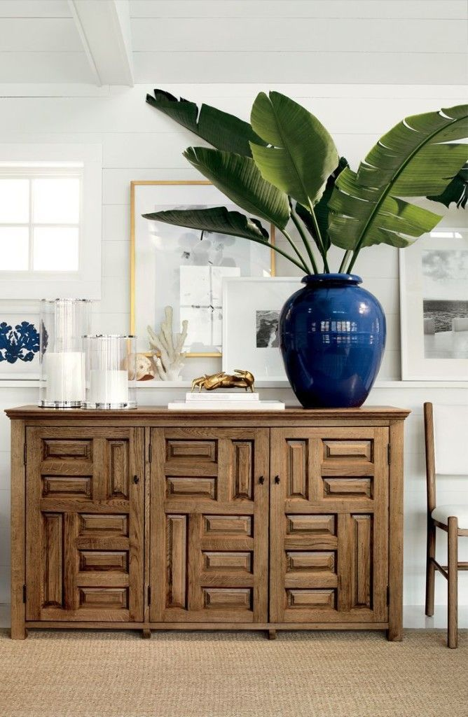 Beautiful Credenza in a tropical retreat with beach accents and a palm plant. Love the navy and white color scheme.