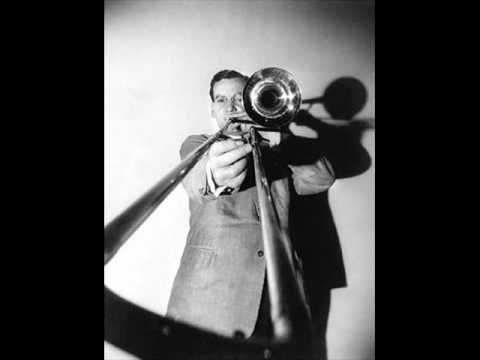 """PENNSYLVANIA 6-5000"" BY GLENN MILLER  Big band music is called such because of having a large ensemble of 12-25 musicians playing various instruments.  Big band music is also considered a form of jazz.  Glenn Miller and The Dorsey Brothers were leaders among big band musicians."