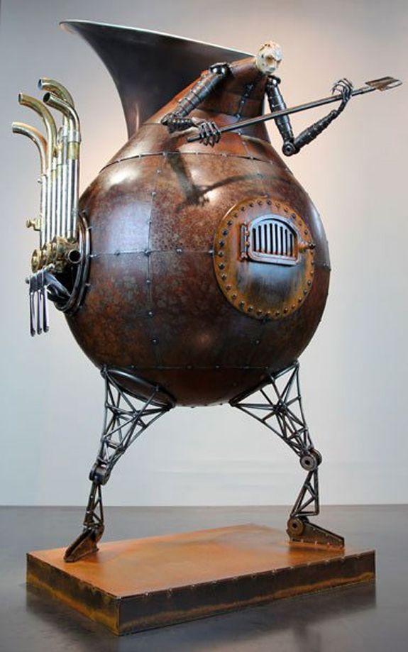 ✿ Re-purposed Creepy Peeps ~ Title: Sounding the Furnace  ~ 2010 ~ Materials: Welded Steel, Concrete, French Horn ~ Artist Greg Brotherton ✿