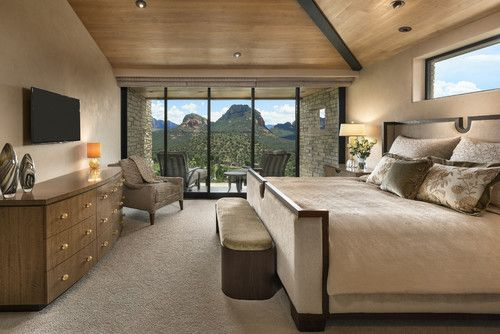 Large hill top home with 360 degree views of canyons, mountains, and golf course. Extensive use of stone tile, slab stone and exotic woods. Enormous pool, multiple spas, putting green,home theater, patios with fire pits, indoor outdoor living | Susan Hersker, ASID - Interior Designer of Arizona #interiordesign #bedroom