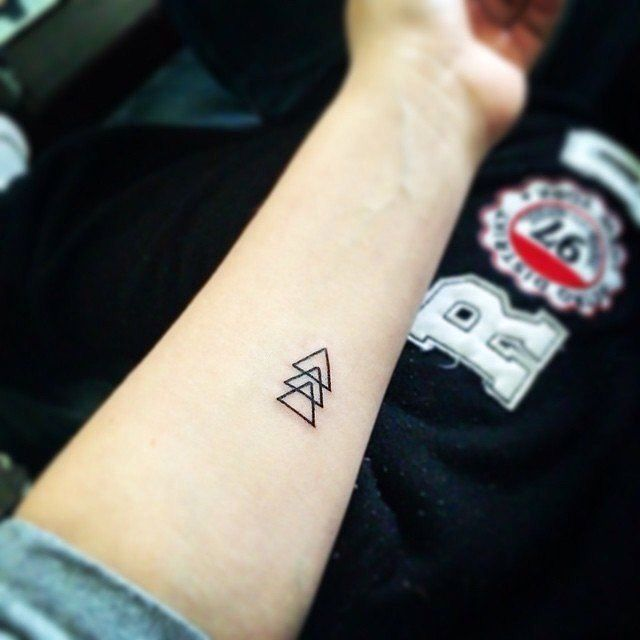 Equilateral triangles are one of the strongest shapes geometrically. They represent strength under pressure and order in all situations. #TattooIdeasStrength